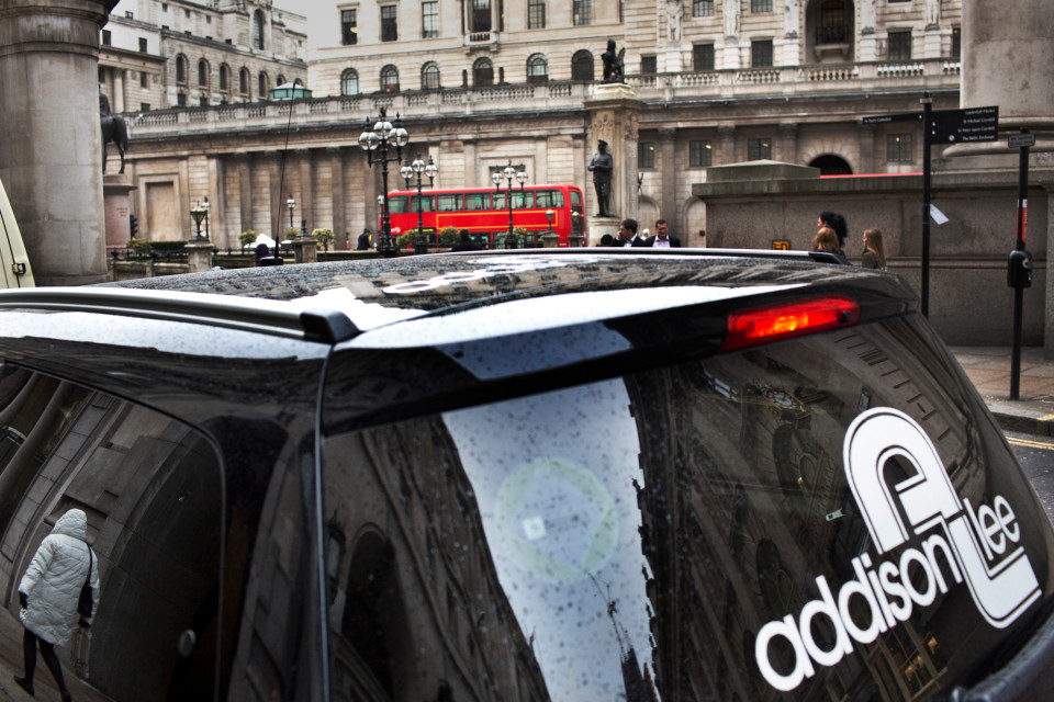February 6th 2012 - London, UK: Addison Lee cars in the City of London. Rob Stothard